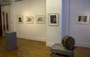 view of framed artwork installed in gallery white walls